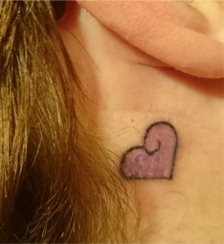Shelly heart tattoo